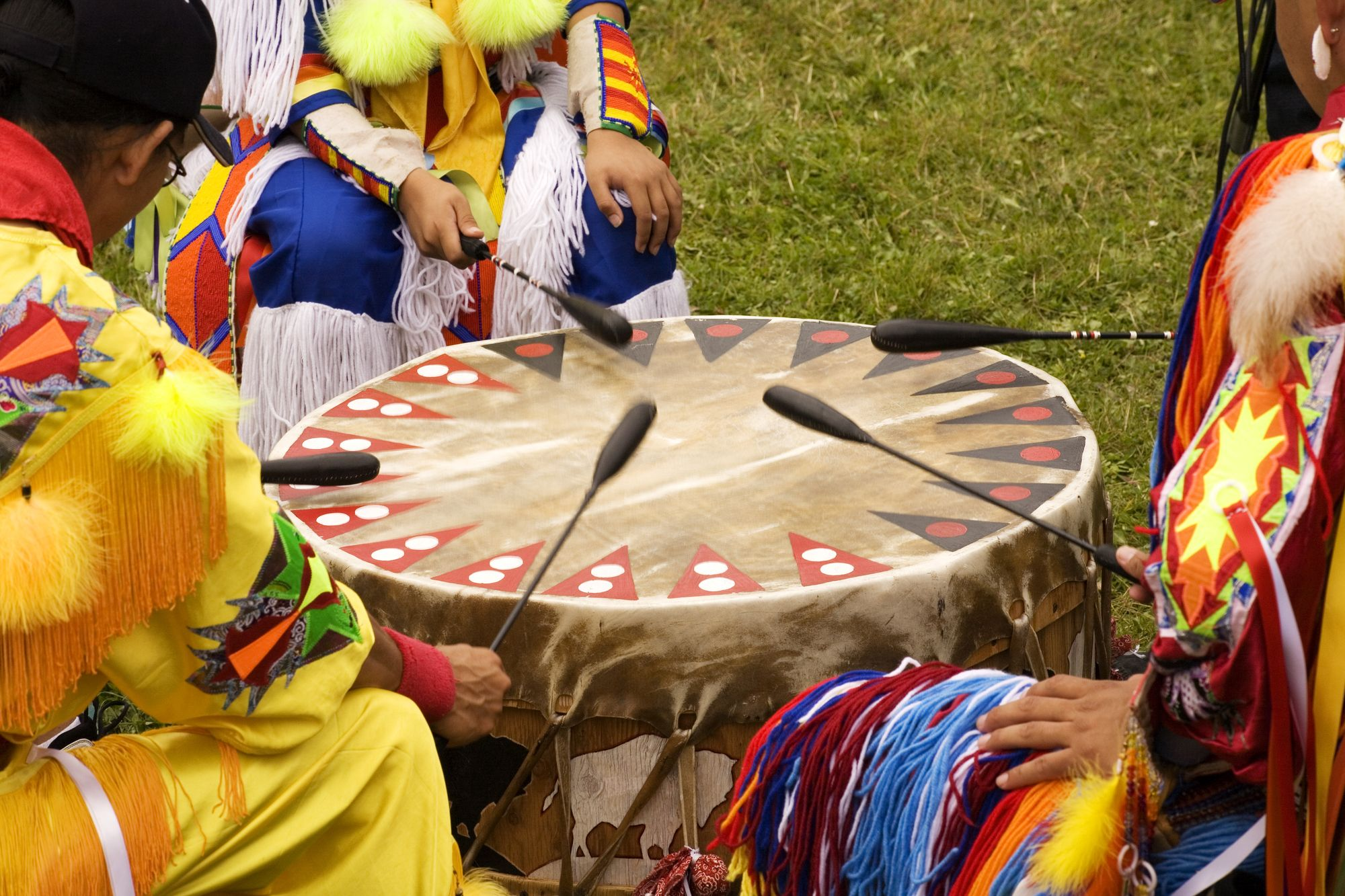 Indians around a drum at a Pow Wow Indians druming